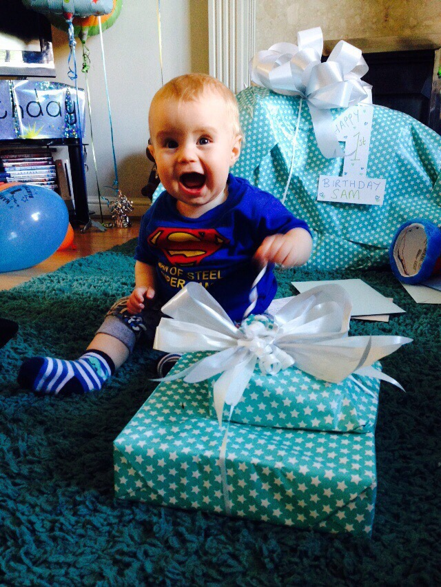 baby excited about his 1st birthday presents